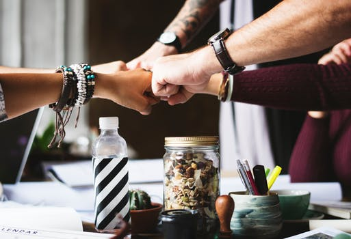 Teamwork hands in the middle employee retention