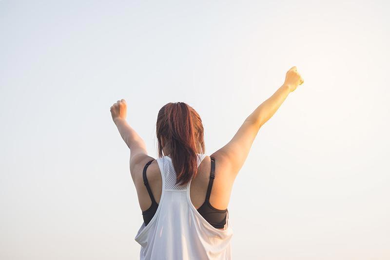 girl-with-white-shirt-feeling-motivated