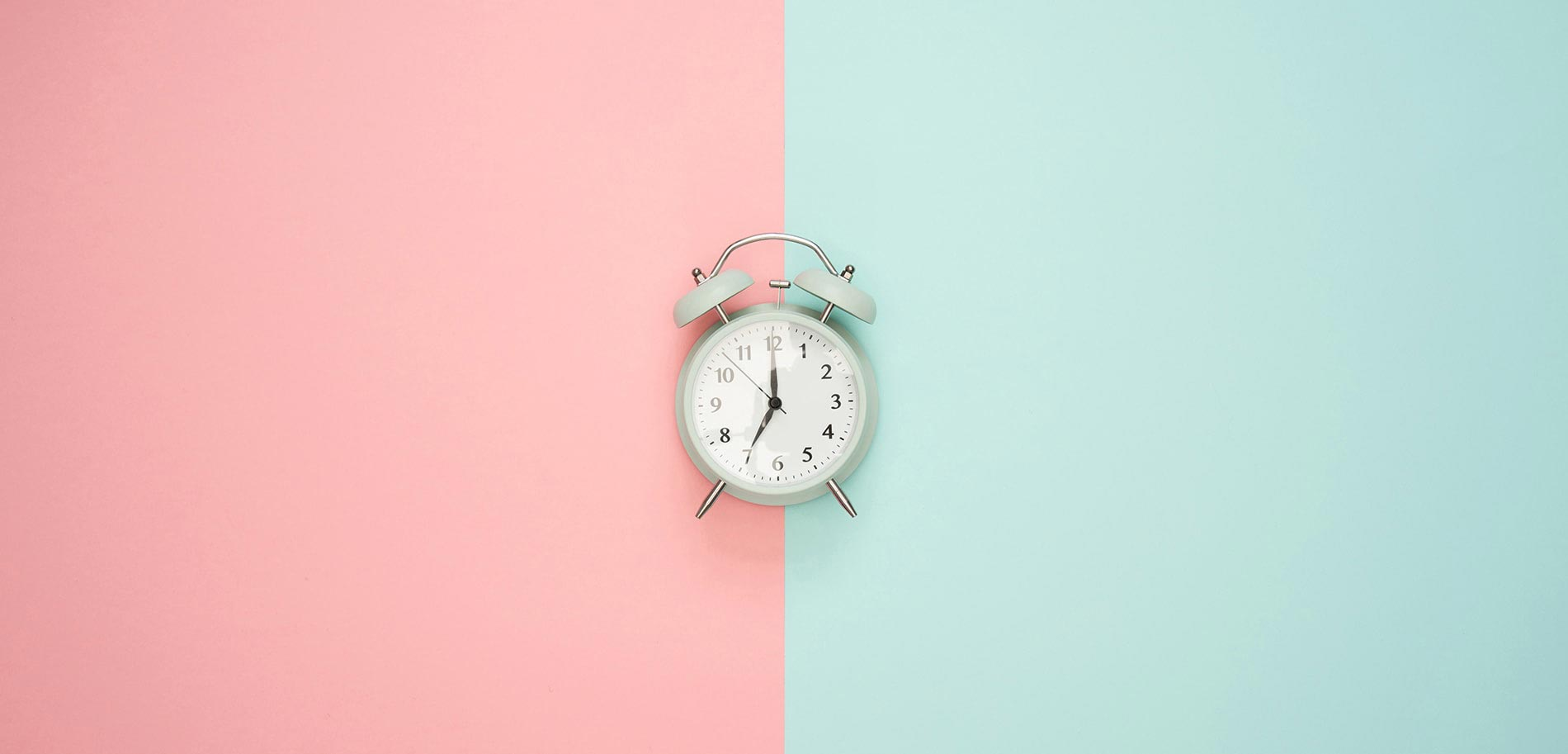 clock-on-pink-and-blue-background