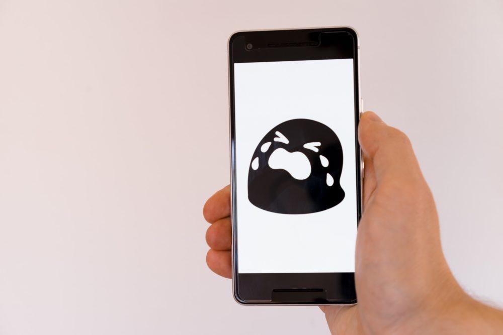 phone with sad emoji